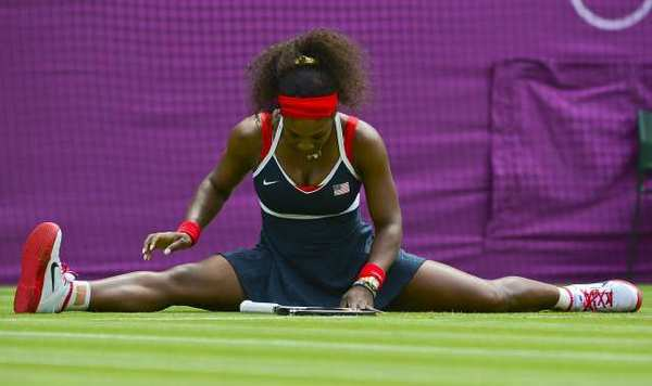Serena Williams falls to the ground during her women's singles tennis match against Serbia's Jelena Jankovic.
