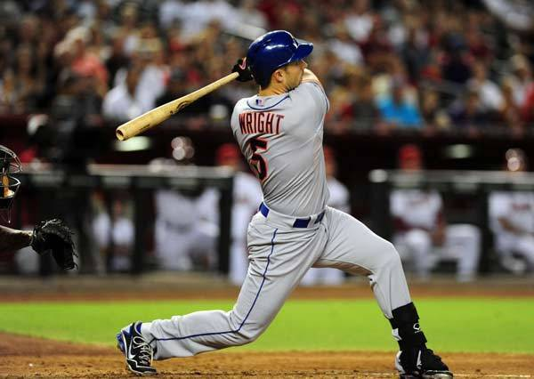 New York Mets batter David Wright (5) hits a home run to left in the third inning against Arizona Diamondbacks at Chase Field.