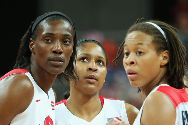 Sylvia Fowles #13 of United States, Maya Moore #7 of United States and Seimone Augustus #5 of United States talk while playing against Croatia in the first half during Women's Basketball on Day 1 of the London 2012 Olympic Games at the Basketball Arena on July 28, 2012 in London, England.
