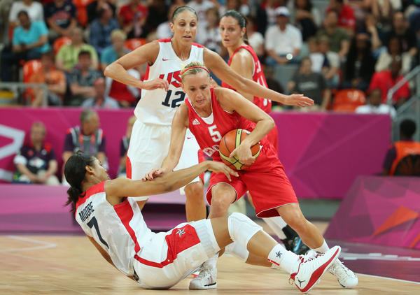 Andja Jelavic #5 of Croatia collides with Maya Moore #7 of United States in the first half during Women's Basketball on Day 1 of the London 2012 Olympic Games at the Basketball Arena on July 28, 2012 in London, England.