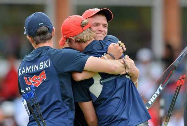 U.S. archery men's team members Brady Ellison, center, Jake Kaminski, left, and Jacob Wukie celebrate as they defeat South Korea in the semifinals.