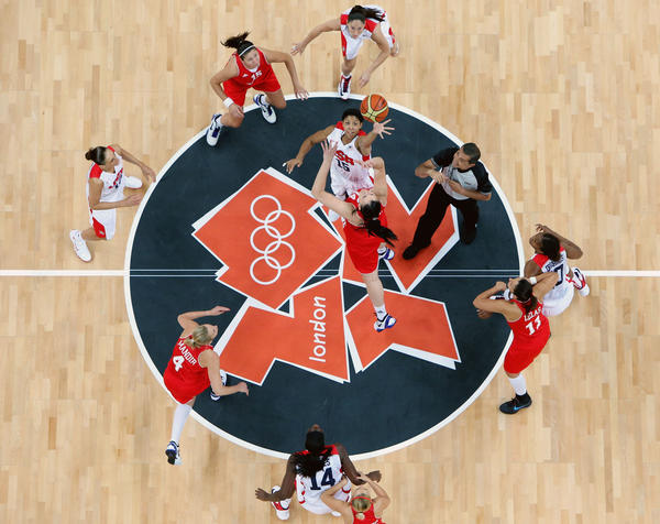 Candace Parker #15 of United States tips off against Luca Ivankovic #14 of Croatia at the start of the game during Women's Basketball on Day 1 of the London 2012 Olympic Games at the Basketball Arena on July 28, 2012 in London, England.
