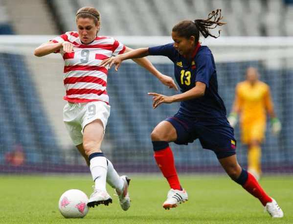 Heather O'Reilly, left, of the U.S. battles for possession with Colombia's Yulieht Dominguez during the first half Saturday.