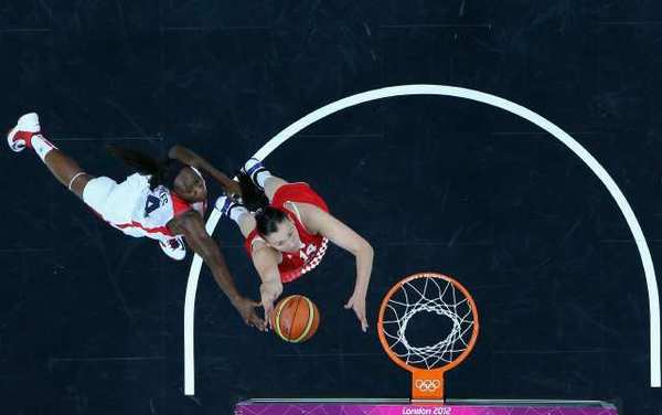 Luca Ivankovic, right, of Croatia and Tina Charles of the U.S. vie for a rebound.