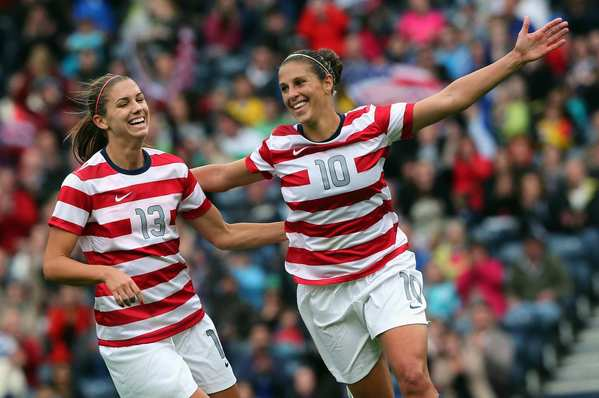 U.S. forward Alex Morgan, left, congratulates teammate Carli Lloyd after Lloyd scored their team's third goal against Colombia during the London 2012 Olympics.