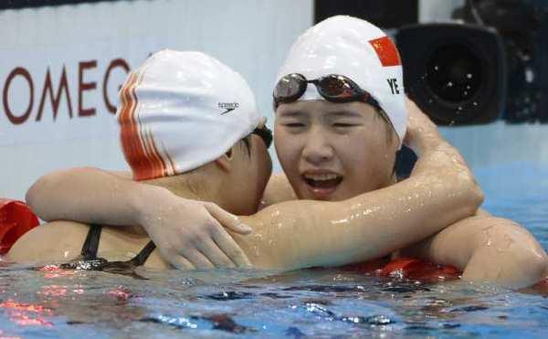 China's Ye Shiwen, right, hugs third-place finisher Li Xuanxu of China after winning in world-record time.