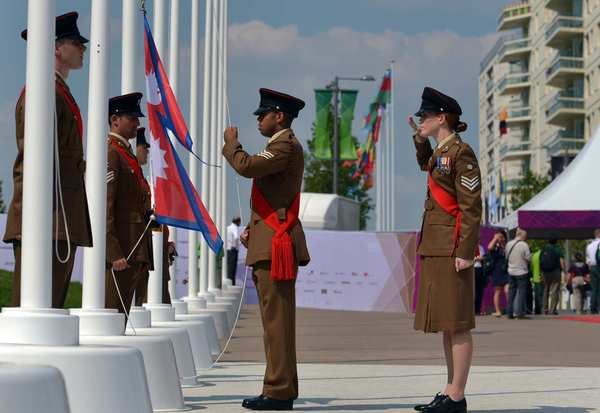 Military personnel hoist the Nepal national flag during the flag-raising ceremony at the Olympic village in London, two days before the start of the 2012 Games. Nepal has sent delegates to 14 Games.