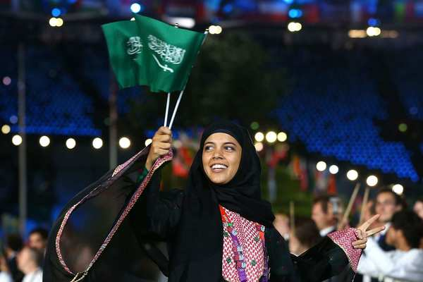 Sarah Attar of Saudi Arabia is all smiles as she enters Olympic Stadium during the opening ceremony on Friday night in London.