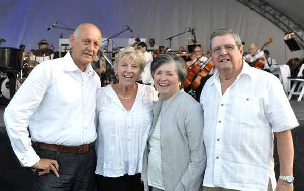 A visitor from Holland, Joop Van der Kleij, left, and his sister Ella Selda, a La Canada Flintridge resident, enjoy the Pops concert at the county Arboretum with Janet and Frank McNiff.
