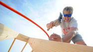 PICTURES:Volunteers from the Sons of a Carpenter build an addition.