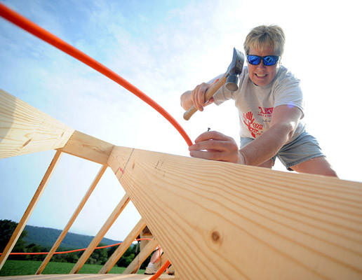 Brenda Vermeulen of New Tripoli, a volunteer for the Sons of a Carpenter of the Lehigh Valley, works on the roof of the aqua therapy spa for Lance Pierce 12, of New Tripoli who was diagnosed with Duchenne Muscular Dystrophy.