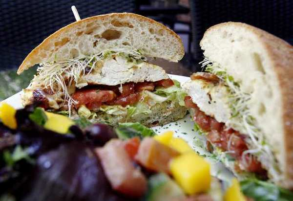 The Chicken Club, of roast chicken with smoked Applewood bacon, tomatoes, lettuce, sprouts and mayo on a toasted ciabatta at Wild Carvery, on the corner of Olive Avenue and San Fernando Boulevard in Burbank, opened five weeks ago and serves natural meats and organic produce for sandwiches, salads, coffee and shakes.