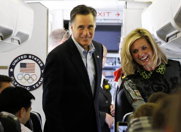 Mitt Romney and his wife, Ann, board a plane in London bound for Israel, where the candidate will meet with Israeli leaders and the Palestinian Authority prime minister.