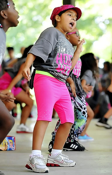 Nicole Reyes, 7, performs with her West End Dance Crew during the Hood Hop Dance Contest held at Doub's Woods Park on Saturday.