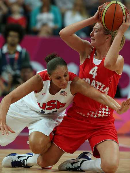 USA defender Diana Taurasi pressures Croatia's Sandra Mandir during a preliminary game at the London 2012 Olympics Basketball Arena.