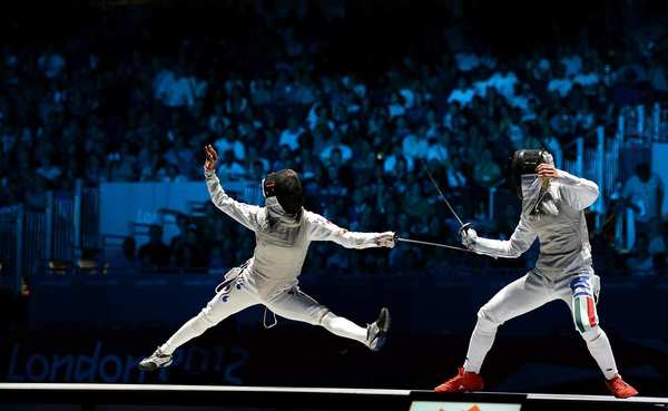 South Korea's Nam Hyun-hee, left, loses to bronze medal winner Valentina Vezzali of Italy in the women's foil individual event.