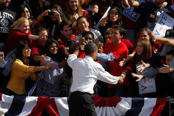 President Obama, greeting students at USC in 2010, ranks ahead of Mitt Romney in likability, polls show. It's unclear how much that will matter in this year's election.