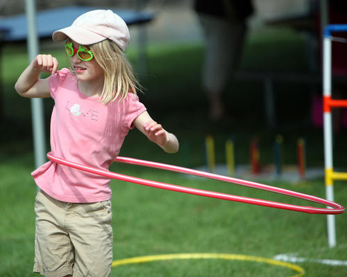 Nadia Anderson, 8, of Shoreview, Mn., plays with a hoop Saturday at the Storybook Land Festival. photo by john davis taken 7/28/2012