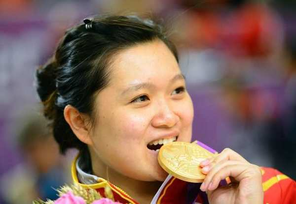 Careful, Wenjun Guo, that gold medal you are biting on is worth $708.