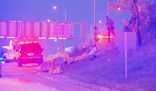 Police on the scene of a crash on the Kennedy Expressway near Armitage Avenue.