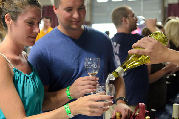 Megan and Mike Serke of Seymour try wines from Jonathan Edwards Winery out of North Stonington.