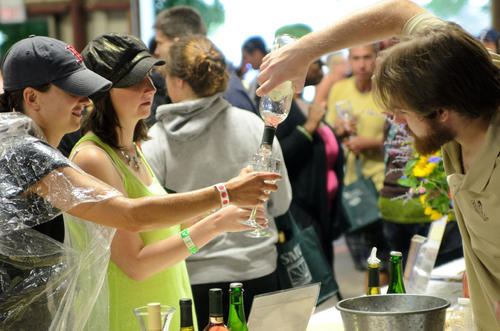 Zsuzsana Mores of Waterbury (left), and Danielle Cormier of Chicopee, Mass., receive pours from Michael Hotkowski of Bishop's Orchard Winery.