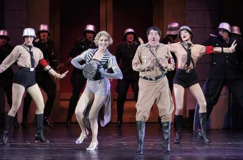 "Rebecca Romijn portrays Ulla and Gary Beach is Roger De Bris in the Hollywood Bowl staging of the Mel Brooks musical ""The Producers."""