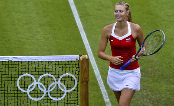 Russia's Maria Sharapova celebrates her victory over Israel's Shahar Peer during their women's singles tennis first-round match. These Summer Games mark the first time athletes have been allowed to wear colors other than white on the courts at Wimbledon.