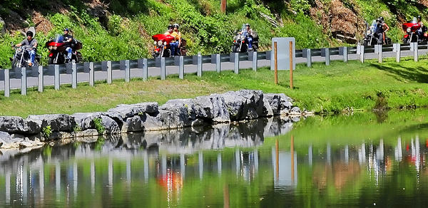Bikers ride along Lappans Road at Devils Backbone Park on Sunday during the Jen Kelly Memorial Ride.