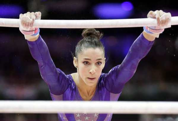 U.S. gymnast Alexandra Raisman performs on the uneven bars Sunday.