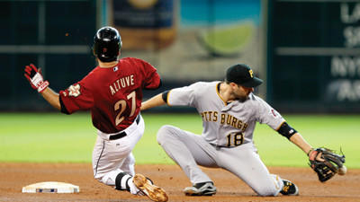 Houston Astros' Jose Altuve beats the ball to second base as Pittsburgh Pirates¿ Neil Walker fails to make the out in the fourth inning on Sunday.