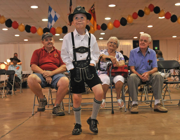 E.J. Johnson, 6 1/2 years old, of Middle River, wearing lederhosen, dances to the German music as his father, Ed Johnson, left, and grandparents, Dorothy and Walter Johnson watch at the 112th German Festival at the Maryland State Fairgrounds on Sunday.
