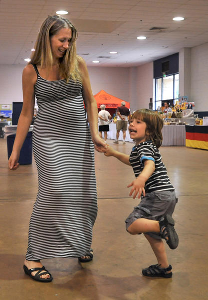Christine Hufnagl-Miller of Timonium dances with her son Max Miller, 3.