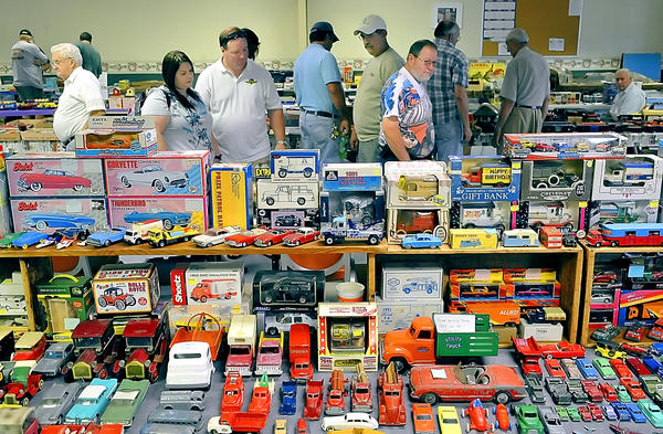 The toy, train and doll show Sunday at the Scotland (Pa.) Community Center had plenty to offer collectors and browsers, as evidenced by the display of toy trucks and cars shown in this photo.