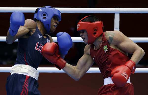 Team USA's Errol Spence fights Brazil's Myke Ribeiro de Carvalho during their men's welterweight boxing match. Spence won the match 16-10 and will advance to the round of 16.