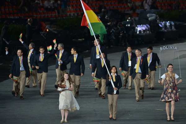 Bolivia's flag bearer, Karen Milenka Torrez Guzman, leads her delegation during the opening ceremony. Bolivia has sent athletes to 17 Games.