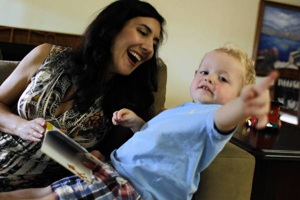 Mary-Louise Hengesbaugh, of Chicago, adopted son Ben, 2, after struggling with infertility. She is now pregnant and due in December.