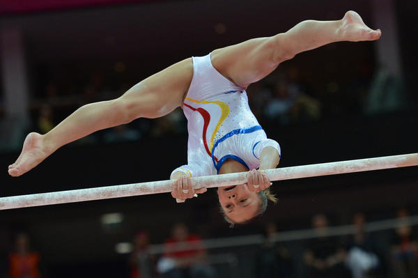 Romania's gymnast Diana Laura Bulimar performs on the uneven bars during the women's qualification of the artistic gymnastics event of the London Olympic Games on July 29, 2012 at the 02 North Greenwich Arena in London.