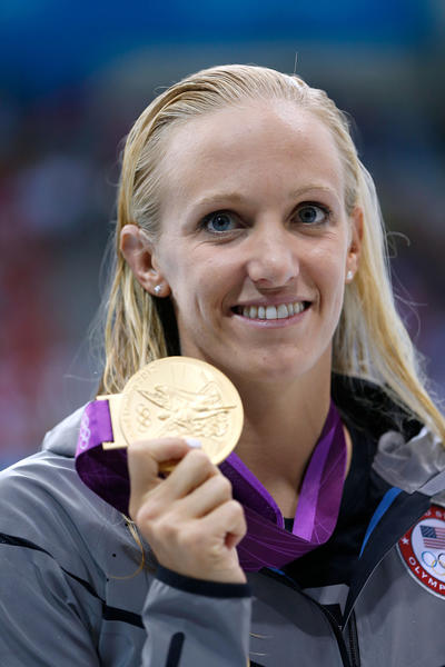 Gold medalist Dana Vollmer of the United States poses with the gold medal after setting a new world record time of 55.98 seconds in the Women's 100m Butterfly final on Day 2 of the London 2012 Olympic Games at the Aquatics Centre on July 29, 2012 in London, England.