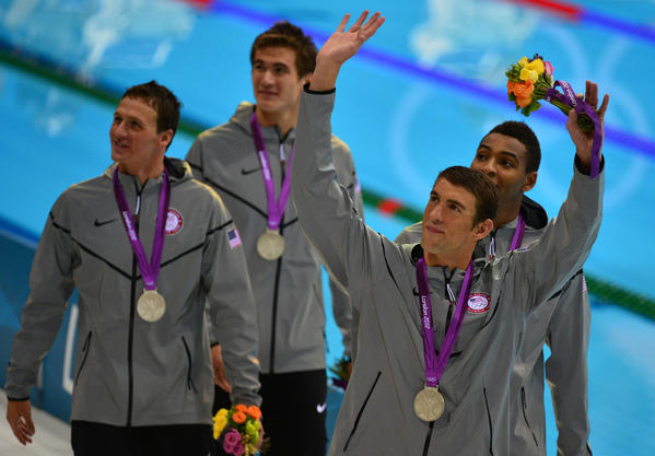 US silver medalist Nathan Adrian, Michael Phelps, Cullen Jones and Ryan Lochte celebrate on the podium the men's 4 x 100m freestyle relay swimming event at the London 2012 Olympic Games on July 29, 2012 in London.