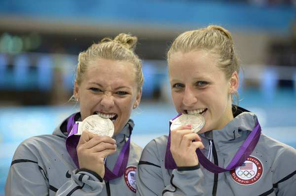 U.S. divers Kelci Bryant, left, and Abigail Johnston pose with their silver medals. They came away with a score of 321.90.
