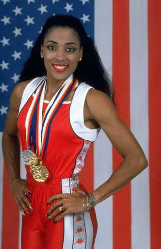Florence Griffith Joyner displays her signature long, painted nails along with the medals she won at the 1988 Summer Games in Seoul.