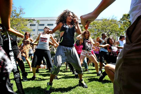 Gina Grant teaches a Zumba Fitness routine during National Dance Day at the Grand Park in downtown Los Angeles on Saturday.