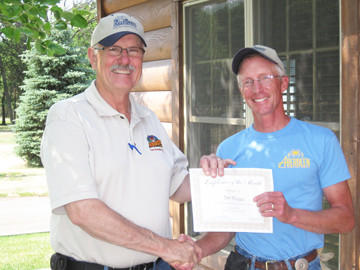 Dan Pirlet, left, Wylie Park manager, congratulates Tim Houge for being the June maintenance employee of the month.