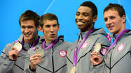 "LONDON — In a turnaround that left <a href=""/sports/olympics/bal-phelps,0,6390519.storygallery"">Michael Phelps</a> and his teammates in stunned silence Sunday night, the 400-meter freestyle relay gold medal that the U.S. had in its grasp slipped away in a late surge by the final French swimmer."