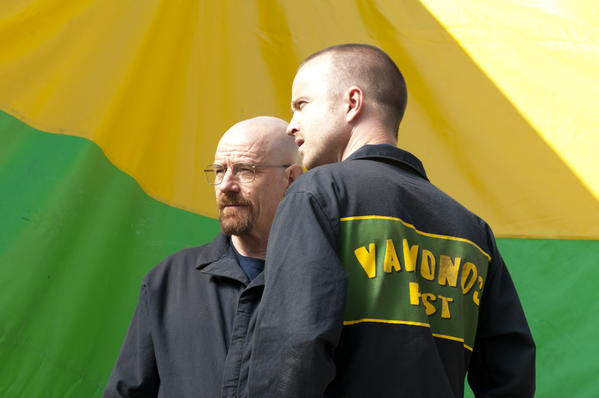 "Walter White (Bryan Cranston) and Jesse Pinkman (Aaron Paul) as Vamonos Pests employees in ""Hazard Pay."""