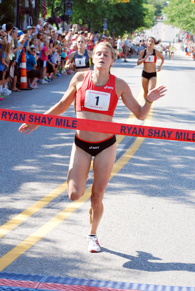 Heather Kampf of Inver Grove Heights, Minnesota crosses the finish line to win the women's race at the annual Ryan Shay Mile Saturday in Charlevoix. Kampf, who runs professionally for ASICS and Team USA Minnesota, set a course record finishing in 4 minutes, 31.83 seconds.