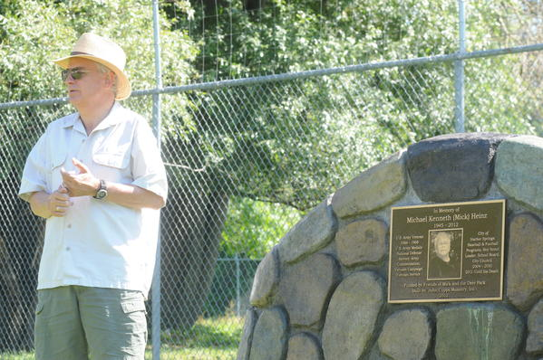 Tom Richards, Harbor Springs city manager, speaks to more than 60 attendees at a dedication Saturday afternoon for a memorial at the city deer park to the late Mick Heinz, a long-time city council member and employee for the city.