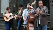 "Though the name may be misleading, there's nothing ""blue"" about the genre-defying five-piece band Too Blue, performing at The Gatehouse Café in Southbury Aug. 7. Following the release of their new album <em>Trouble with the Grey</em>, that's garnered noted airtime and stellar reviews, the native Connecticut and New York band is making national news and earning quite the following in their home states. Blending bluegrass, jazz, swing and Celtic, Too Blue, made-up of Betsy Rome (guitar and vocals), Joan Harrison (banjo and vocals), Michael Sassano (mandolin), Jamie Doris (bassist), and Kalia Yeagle (fiddle) delivers an eclectic and adventurous performance filled with lush harmonies, catchy finger-pickin', and a sound that can't be pinned down."
