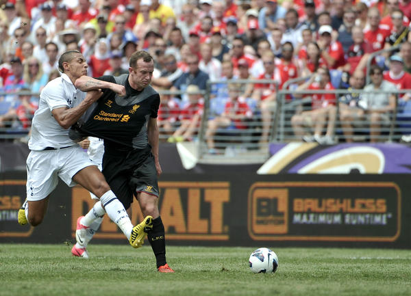 Tottenham Hotspur player Jake Livermore (left) tangles with Liverpool player Charlie Adam in the first half of a friendly match at M&T Bank Stadium.
